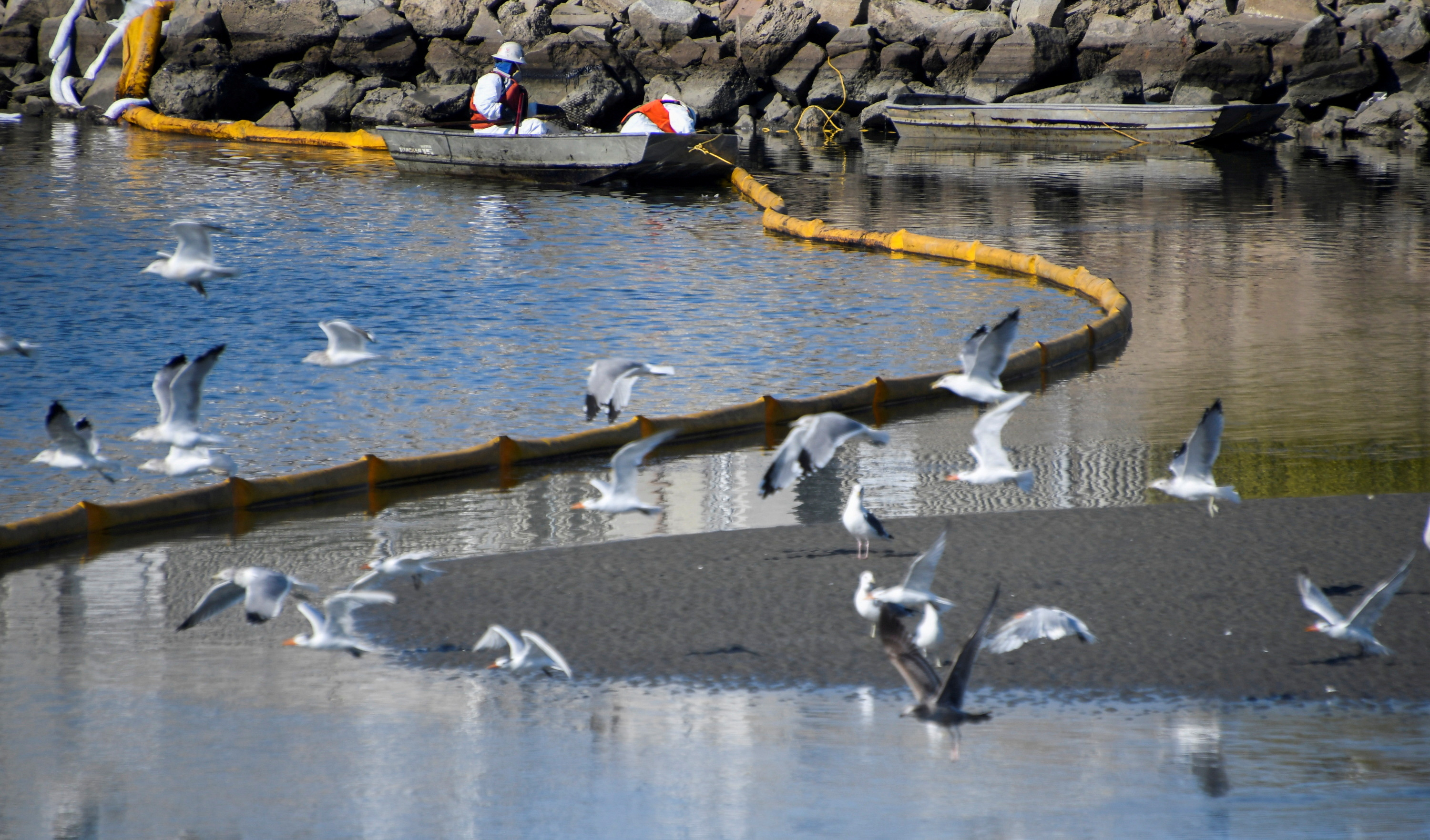 A clean-up team works on clearing the oil slicks at the Talbert Channel after a major oil spill off the coast of California has come ashore in Huntington Beach, California, U.S. October 3, 2021. REUTERS/Gene Blevins
