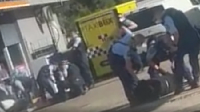The altercation occurred at a Guildford service station on Friday afternoon.