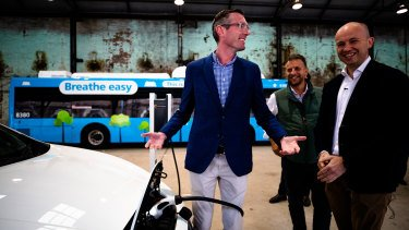 Treasurer Dominic Perrottet, Minister for Transport and Roads Andrew Constance, and Minister for Energy and Environment Matt Kean at the EV policy launch in June.